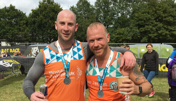 """We did it!""  Dan and James celebrate after completing the Lakes Challenge in seven hours!"