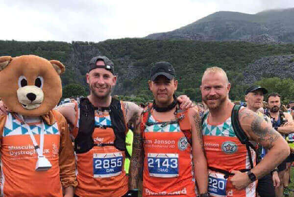 Jenson's dad Craig Edwards in Bear Costume, next to Dan Davies, Craig Hughes and James Beck, against the backdrop of Mount Snowdon, after the Snowdon Trail Half Marathon the week before.